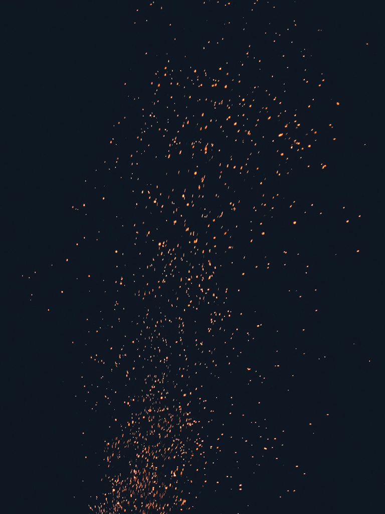 Embers flying through black sky halloween photo booth backdrop
