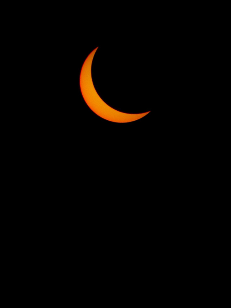black background with orange crescent moon
