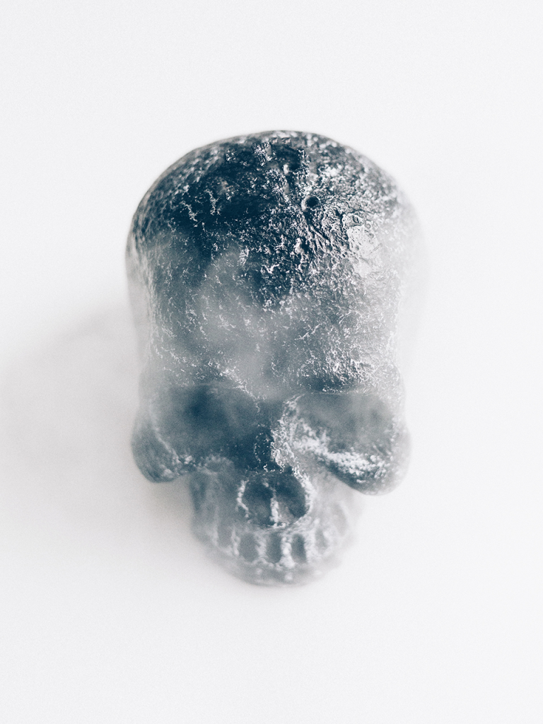 metallic skull on white photo booth background and fog
