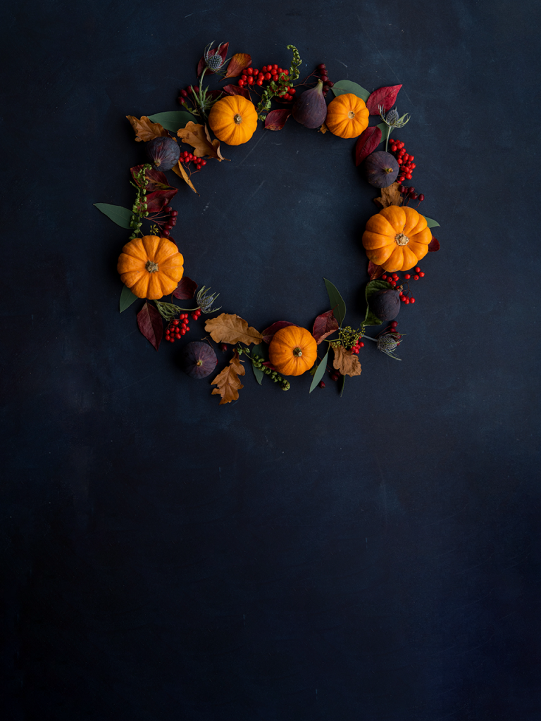 halloween wreath on black chalkboard photobooth background