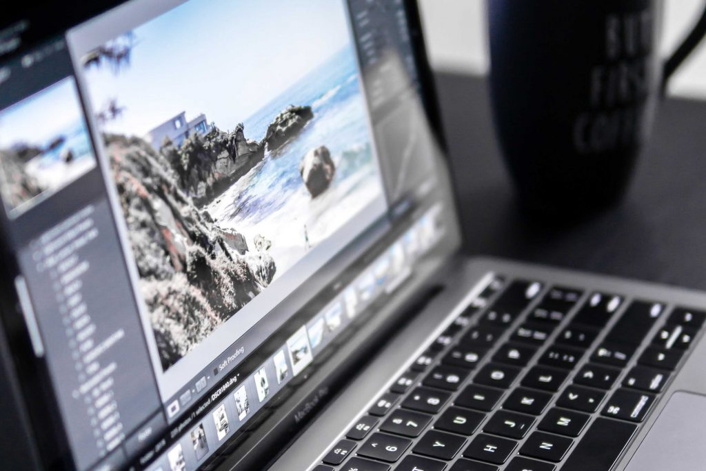 image editing program being used on laptop computer