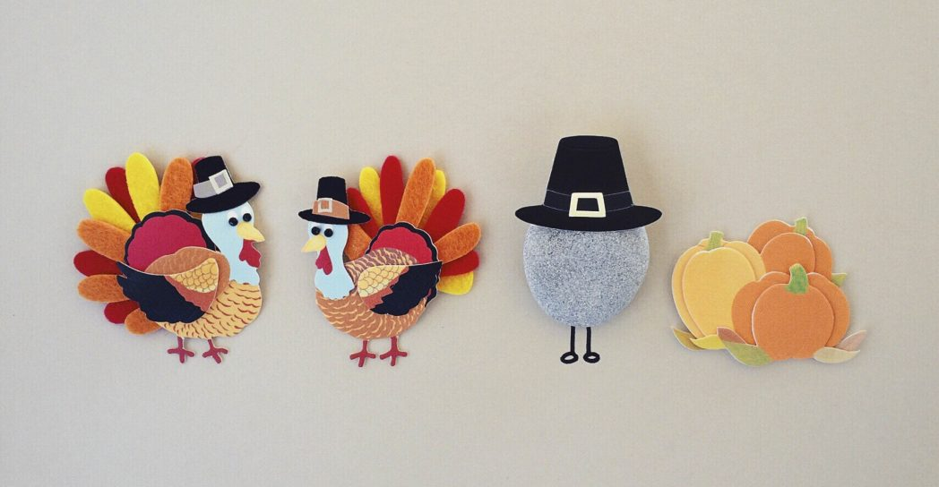 two felt turkeys and a rock