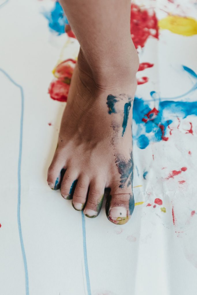 kids foot with paint on it
